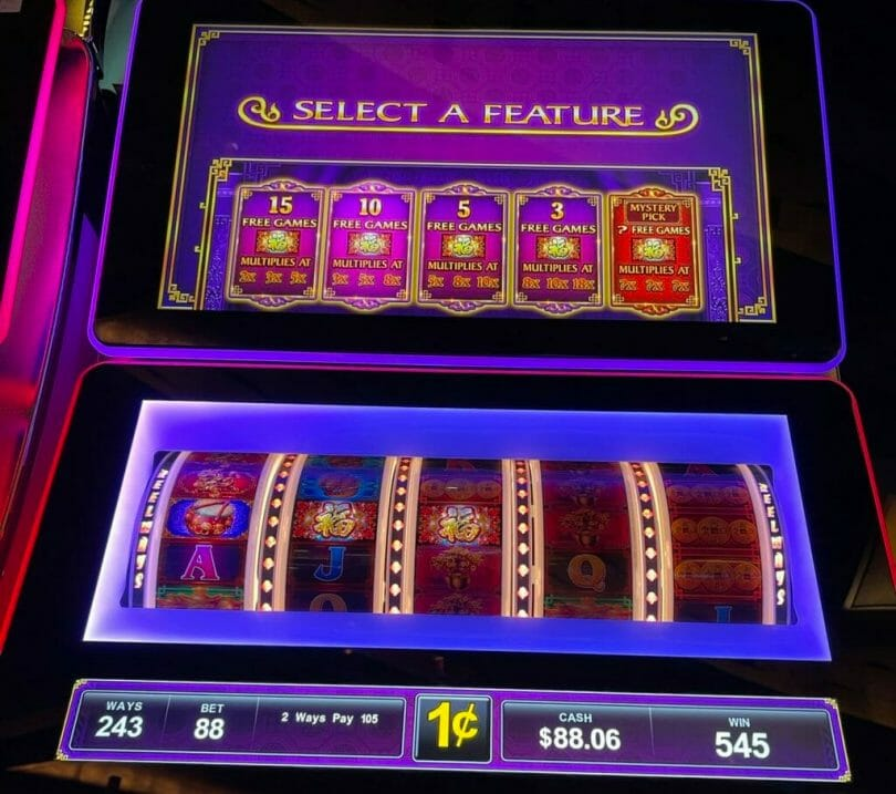 Dancing Drums Reels by Scientific Games select a feature