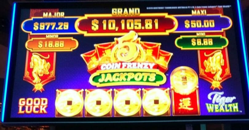 5 Coin Frenzy Jackpots by Aristocrat 5th coin lands